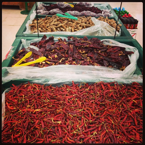 Large bins of chiles at the supermarket
