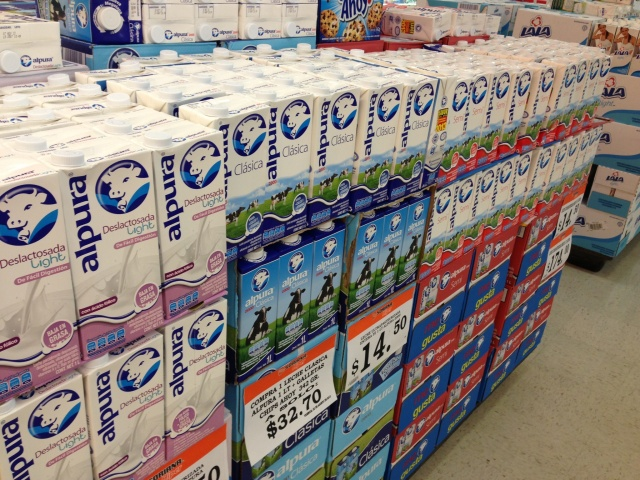 Milk stacked in the aisles of the supermarket