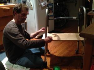 David constructs a knee platform for me on his mom's unused walker.