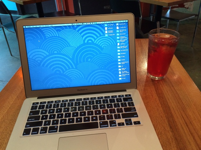 Laptop and iced tea.
