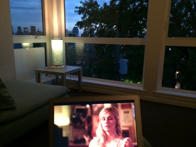 Watching shows on my laptop while the sun sets out my window.