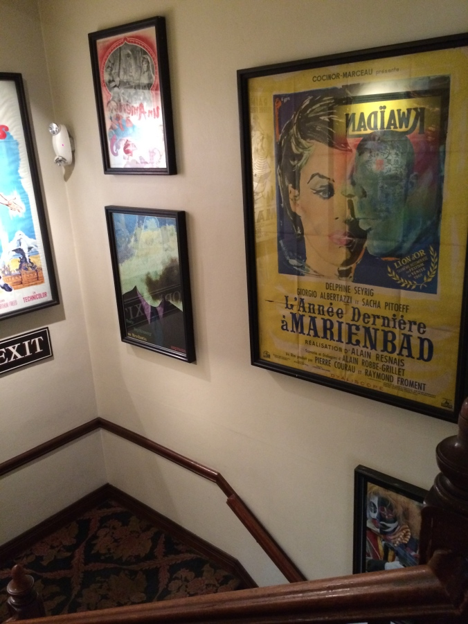 Movie posters in the Harvard Exit Theater.