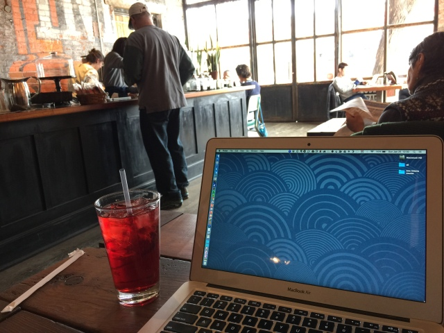 macbook air & iced tea at Exo Roast