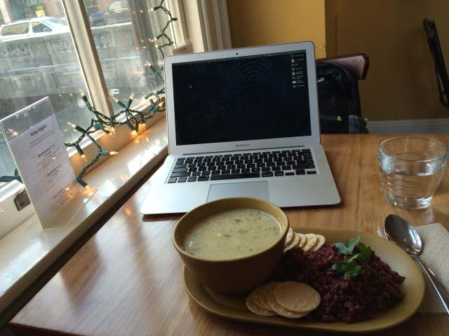 Laptop and food in North Branch Cafe.