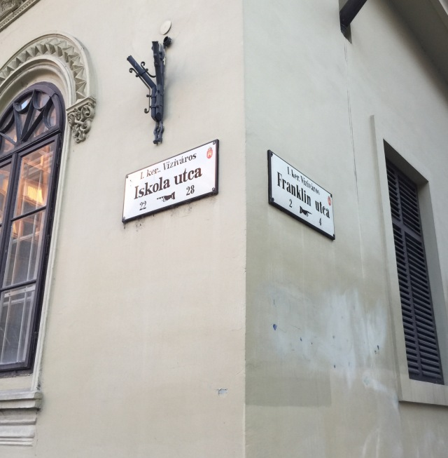 street signs on the corners of buildings