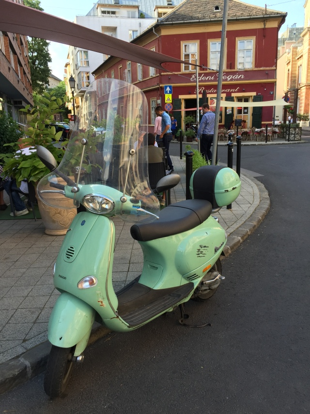 Pretty light green Vespa.