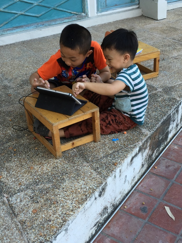 2 boys enjoying their tablet