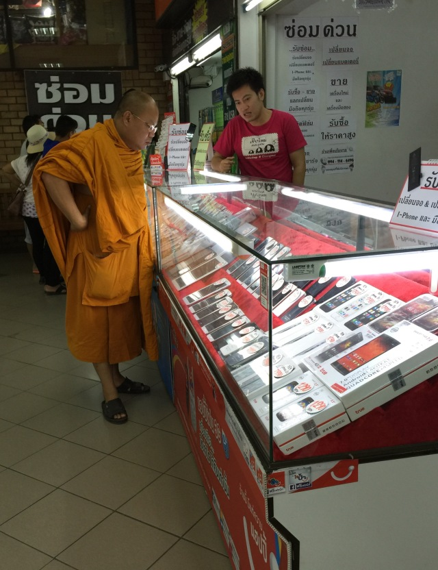 monk shopping for smartphone at the mall