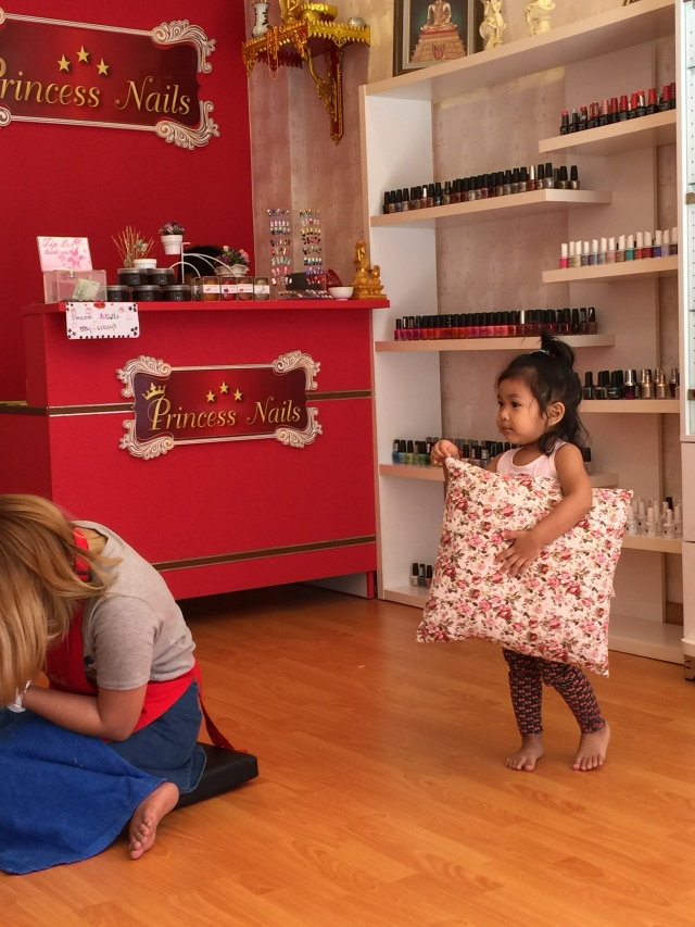 inside the nail salon, cute little girl