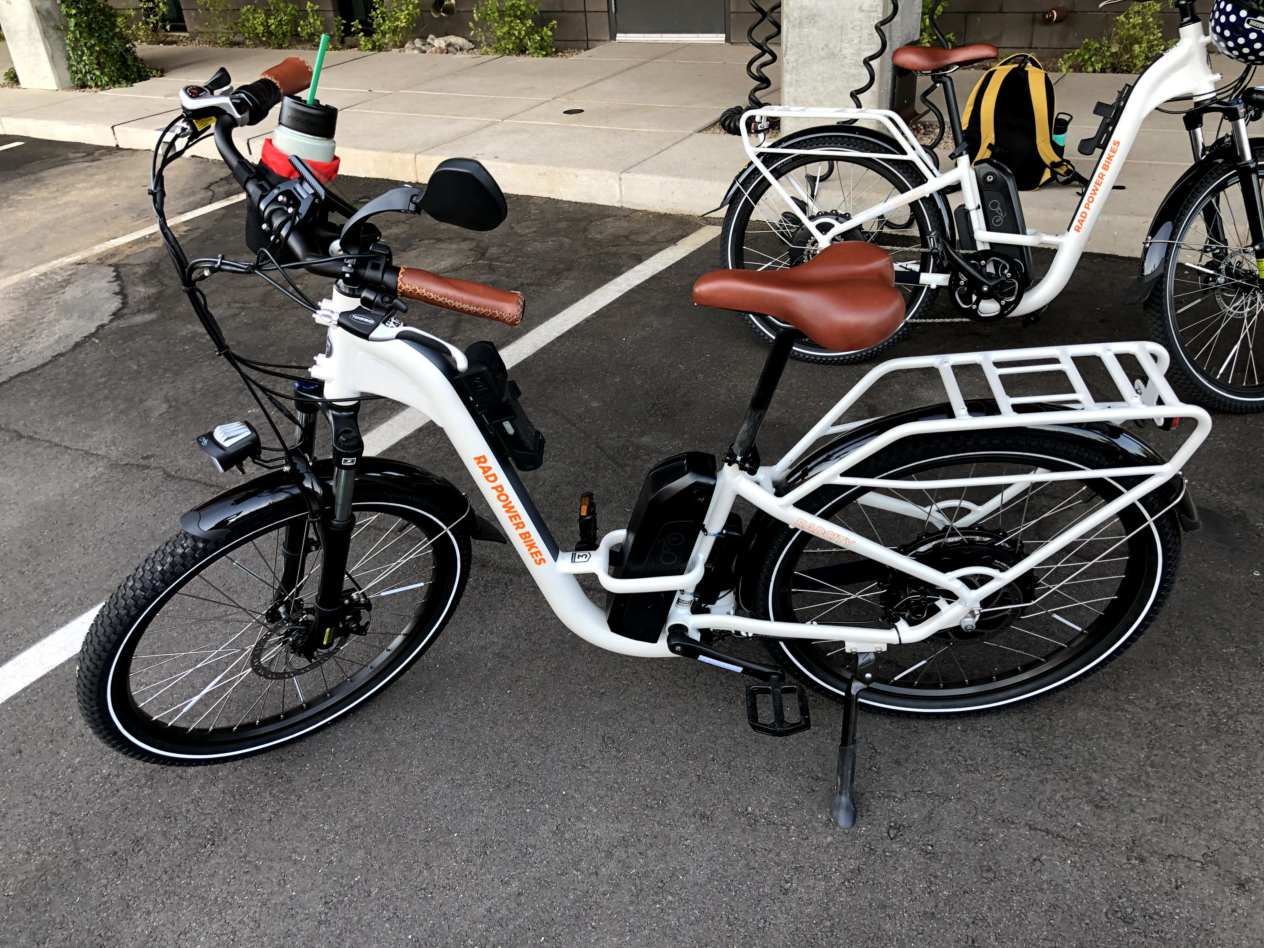 two white electric bikes