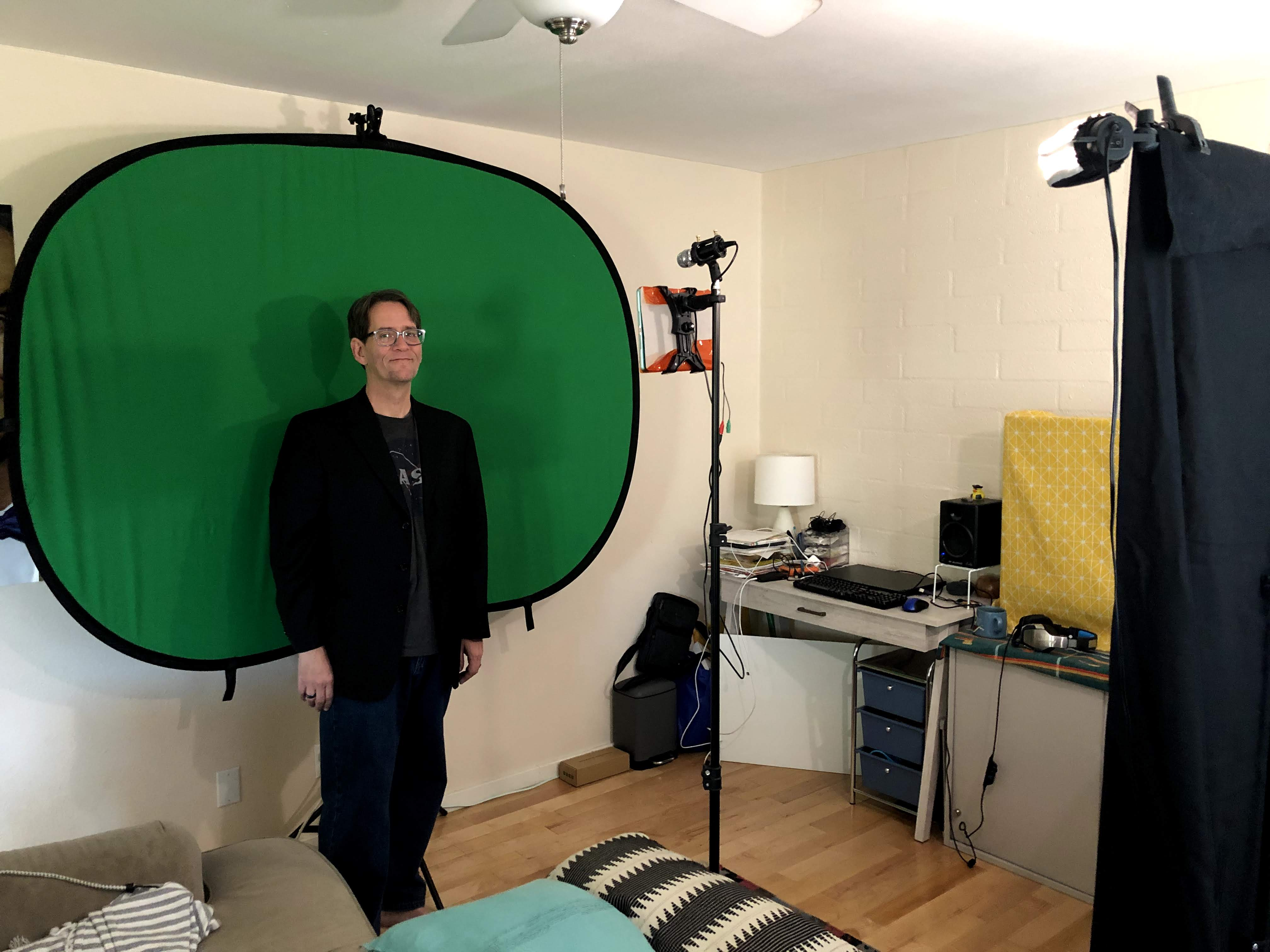 James standing in front of portable green screen.