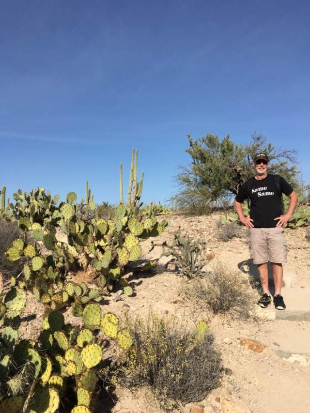 Man with black t-shirt in the Tucson desert.